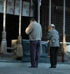 People praying at a Japanese Shinto shrine